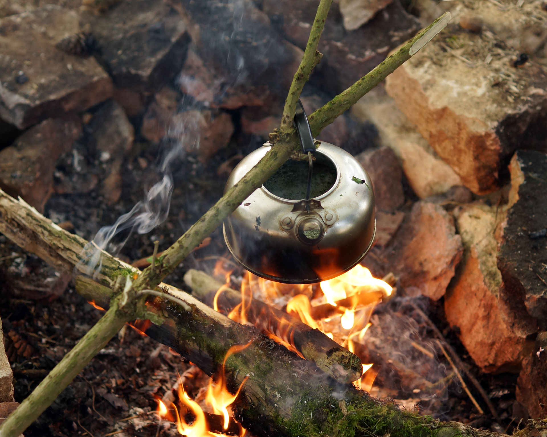 Coffee break during bushcraft course in Lapland