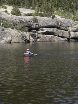 Fishing from floating tube in Lapland